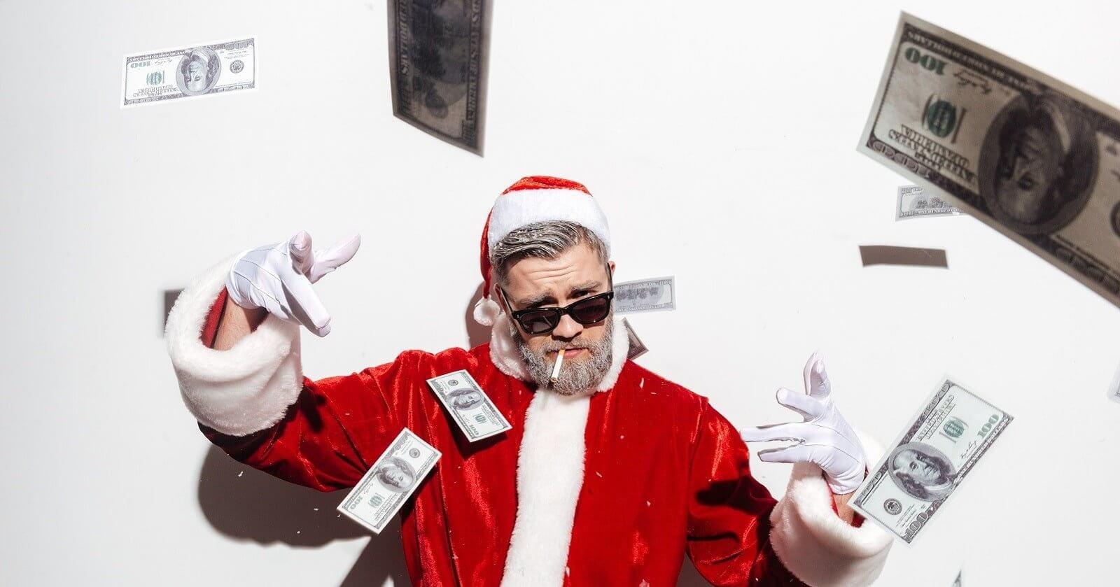 Weihnachtsmann wirft Geldscheine